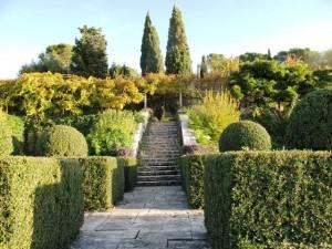 The stone steps of La Foce's terraced garden draw the eye upward, towards two large Italian cypresses
