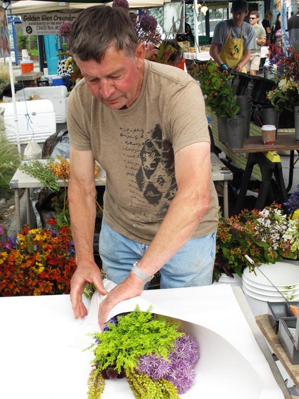 Jan shares his vast knowledge with regular farmers market customers each weekend.