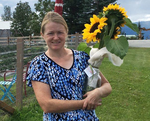 Kelly Dellan of Wasilla Lights Farm, with her sunflower crop